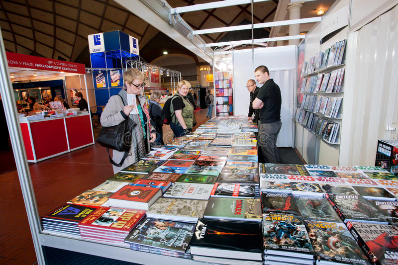 People look at comic books and graphic novels stock image