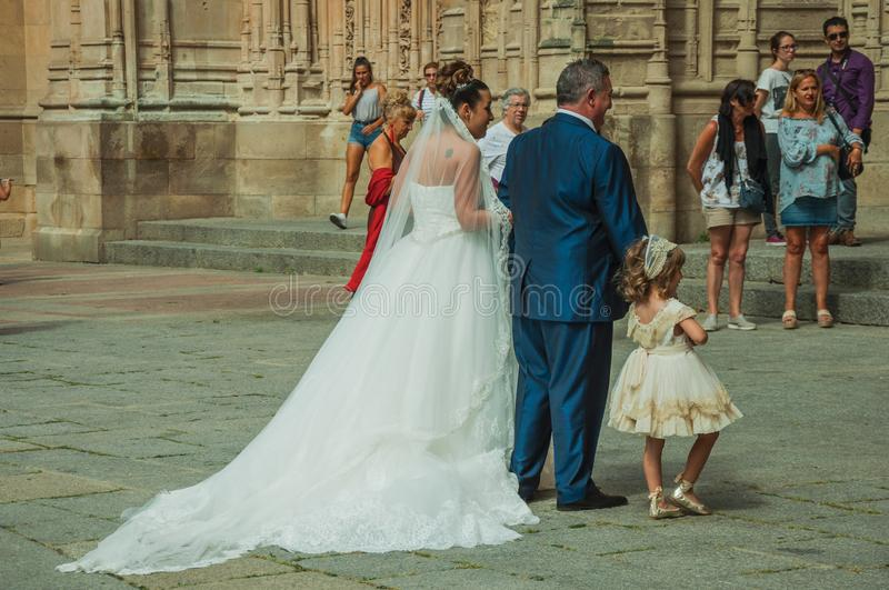 People looking at bride in front the New Cathedral at Salamanca. Salamanca, Spain - July 21, 2018. People looking at bride enter through the door of the New stock photo