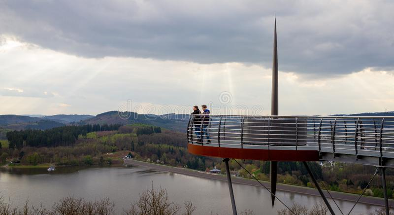 People looking down from the Sky Walk near Attendorn. Germany royalty free stock image