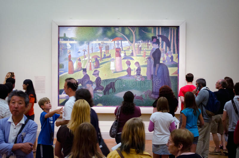 People looking at a famous painting stock photo