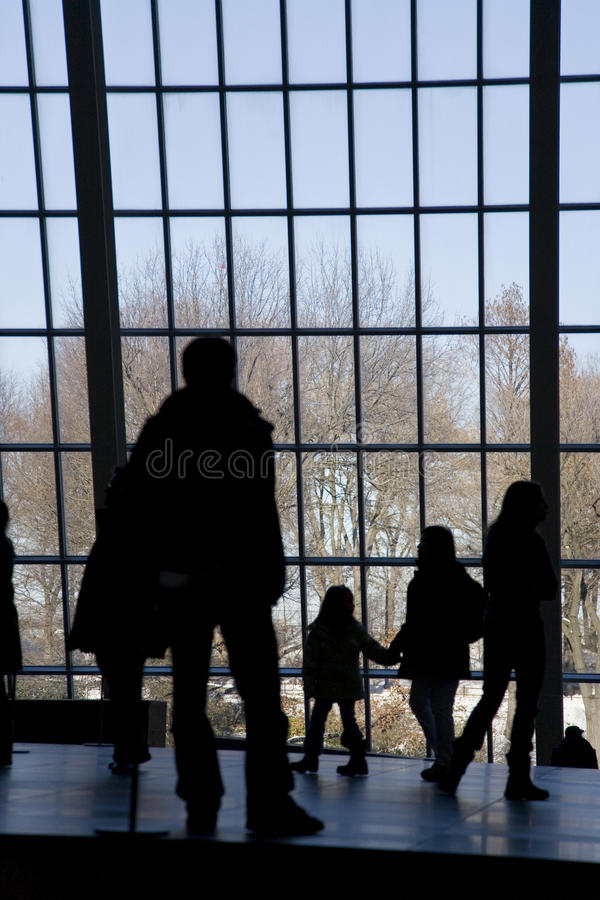People Looking Out Window Stock Photography