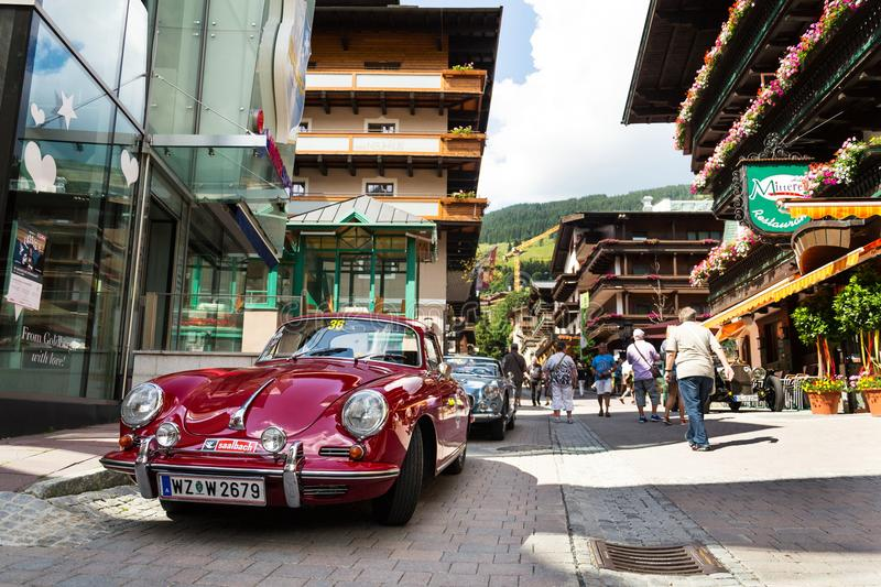 People looking at Porsche 356 oldsmobile vintage veteran cars preparing for Saalbach Classic rally in Saalbach-Hinterglemm stock photo