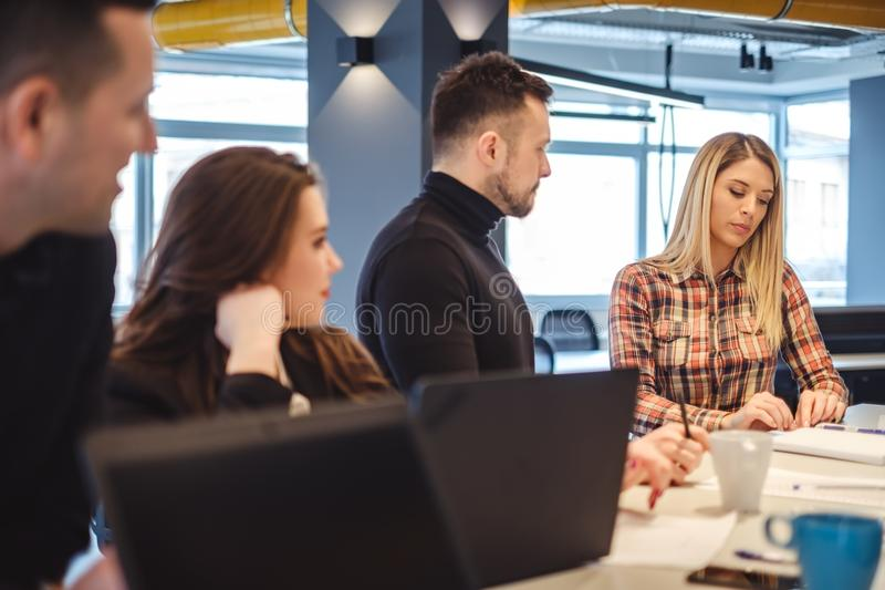 People looking at their sad female colleague at office meeting royalty free stock photo
