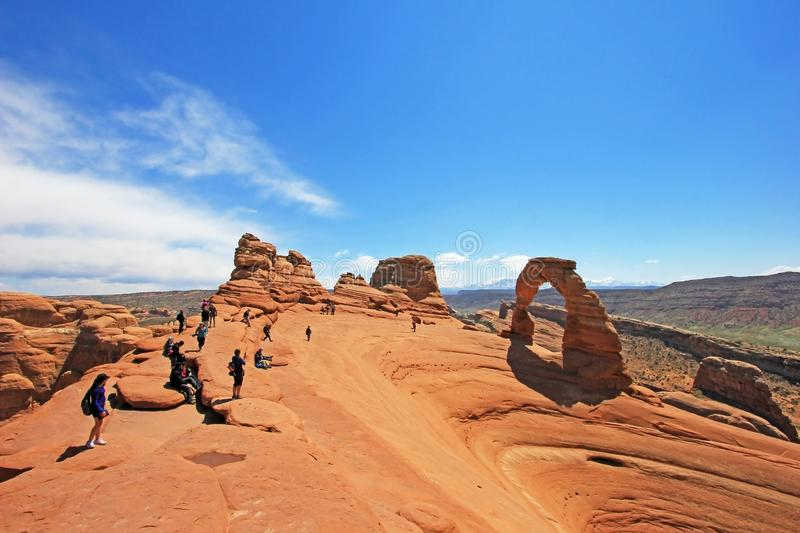 People looking toward Delicate Arch at Arches National Park, Utah stock image