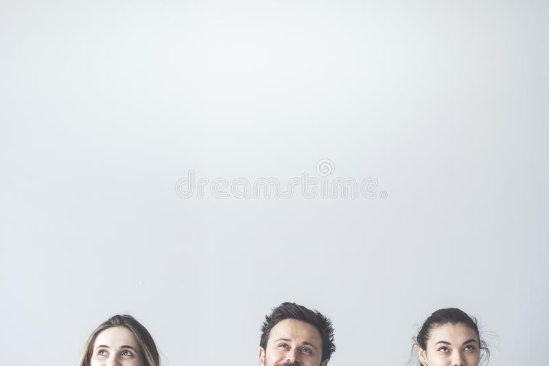 People looking up on gray background royalty free stock images