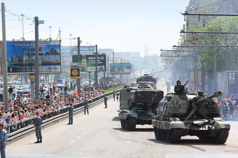 People looks on weaponry and tank on road. MOSCOW - MAY 9: People looks on weaponry and tank on road on parade in honor of Great Patriotic War victory on May 9 stock photography