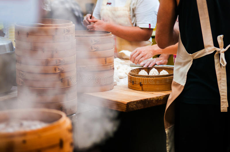 People are making Xiaolongbao, soup dumplings, Xiao long bao, Ch. Chinese Dim Sum, delicious Xiao long bao stock photography