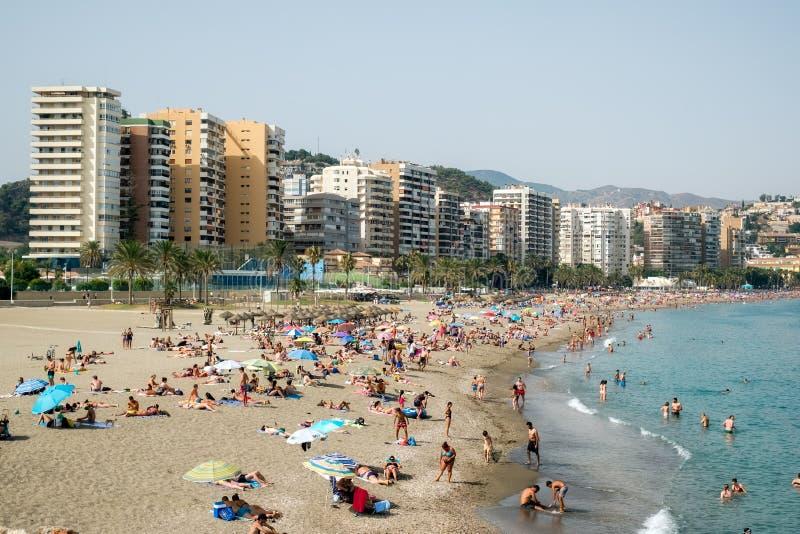 People on Malagueta beach. Malaga Spain - July 27, 2018. People on Malagueta beach, Malaga, Costa del Sol, Malaga Province, Andalucia, Spain, Western Europe stock photos