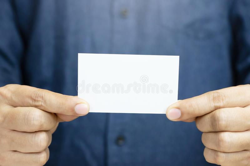 People man hand hold business cards show blank white card mock up stock image