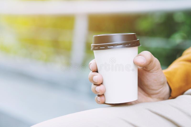 People man hand holding paper cup of take away stock image