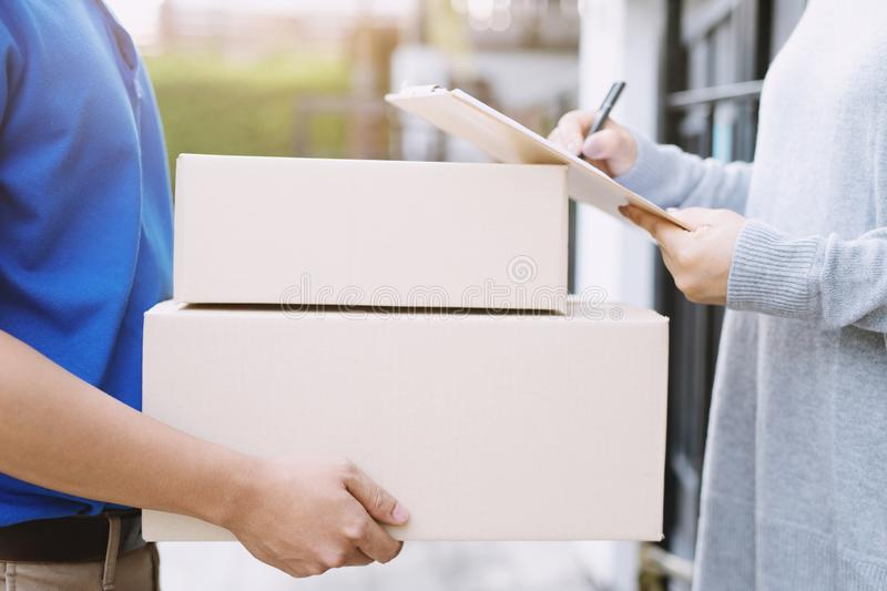 People man signing receipt receiving package parcel delivery man of a package. Through a service. and close up hand customer accepting a delivery of boxes stock image