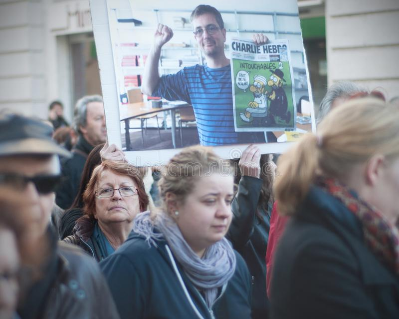 People are marching in a citizen march in Angouleme, France on the 11th of January 2015 after the killing at Charlie Hebdo royalty free stock image