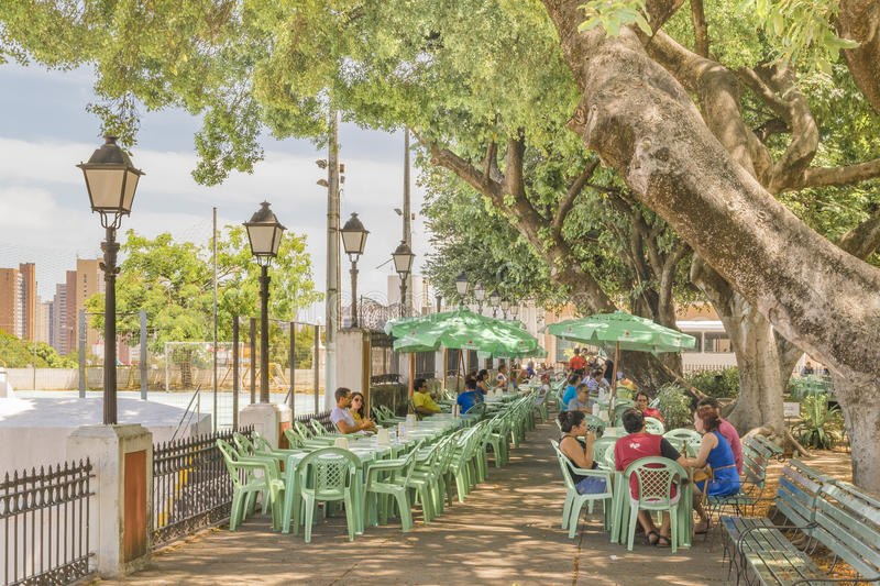 People at Martyrs Square Fortaleza Brazil. FORTALEZA, BRAZIL, DECEMBER - 2015 - People at outdoor restaurant at Martyrs square or passeio publico, the most royalty free stock photos