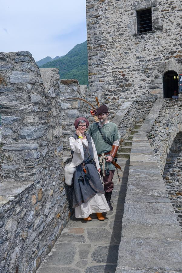 People on medieval characters at Castelgrande castle in Bellinzona on the Swiss alps stock image