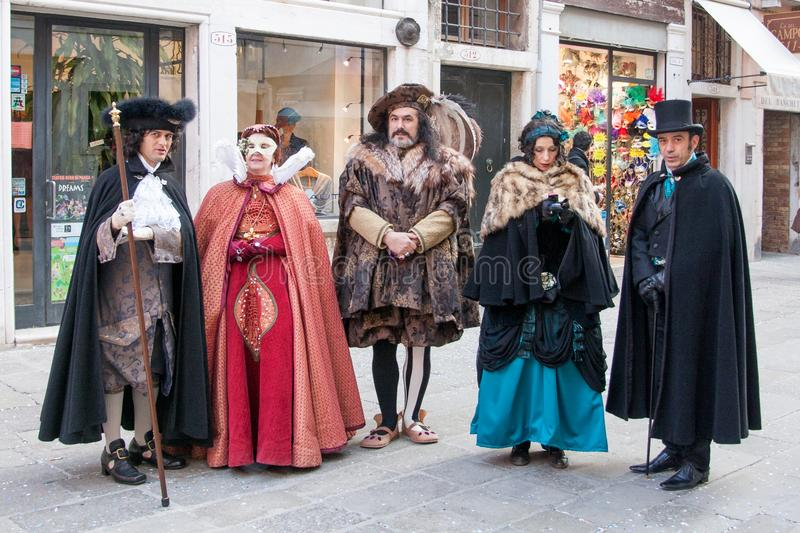 People in medieval costumes at the Carnival, Venice, Italy. Group of costumed people in Venice for carnival, Italy stock photo