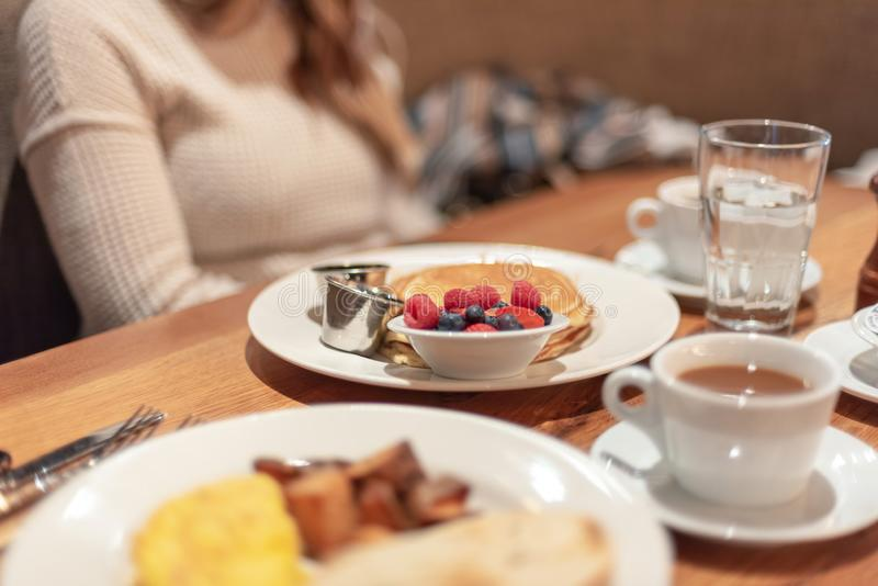 People meeting for breakfast. People meeting for a casual breakfast, brunch food and coffee on table royalty free stock photo