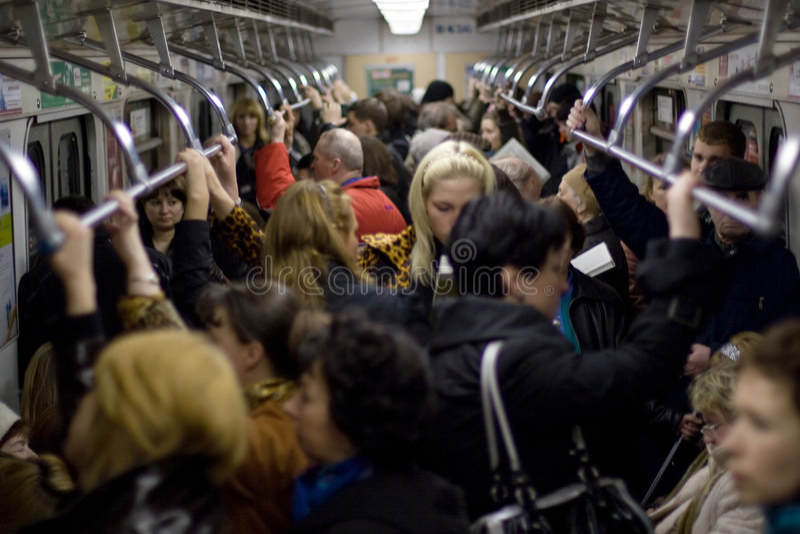 People in metro car stock image