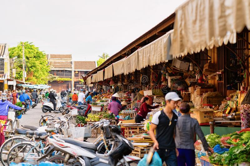 People mopeds and street local market in Hoi An royalty free stock photo