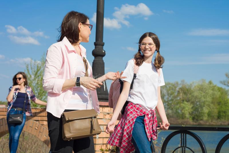 People, motherhood, family, summer. - Happy mother and daughter talking outdoors. stock photography
