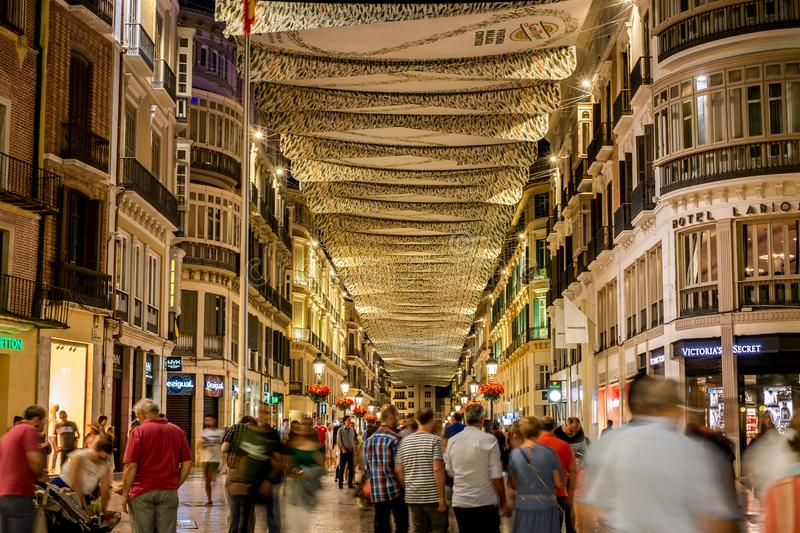 People in motion on the Marques de Larios pedestrian street at night stock photography