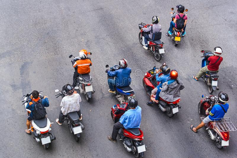 People are on motorbikes in huge Asian city. Bangkok royalty free stock photography