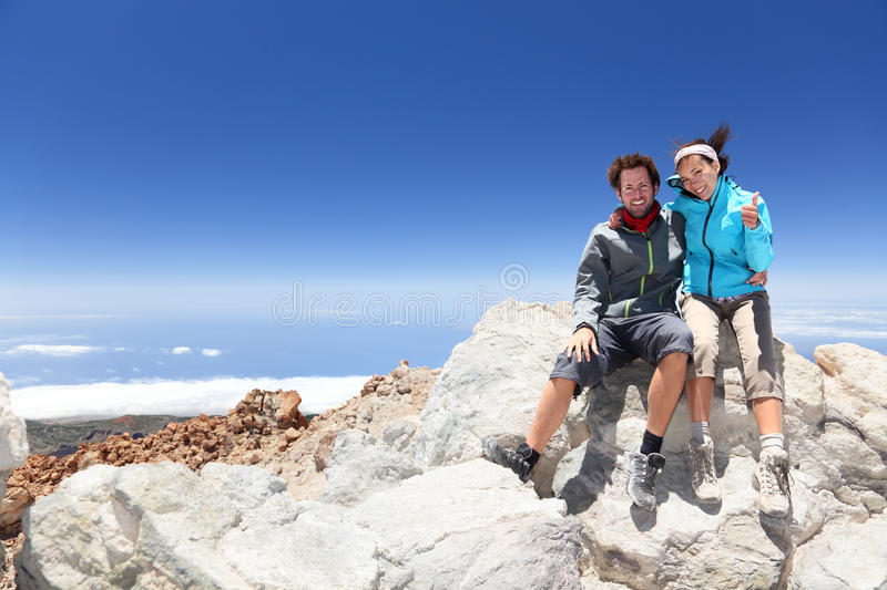 People on mountain top hiking royalty free stock image