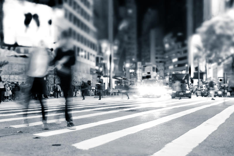 People moving in crowded night city street. Hong Kong. Blurred image of people moving in crowded night city street. Art toning abstract urban background. Hong royalty free stock photos