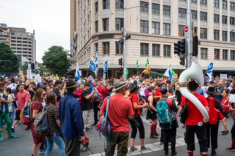 People and musicians marching in a climate change protest in Sydney stock photography