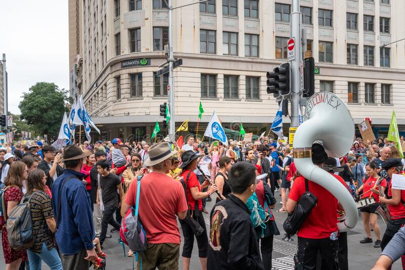People and musicians marching in a climate change protest in Sydney royalty free stock image