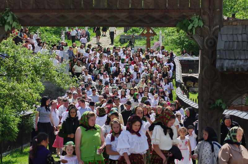 People in traditional national costume - landmark attraction in Maramures, Romania. People in traditional national costume returning from church, on Sunday stock image