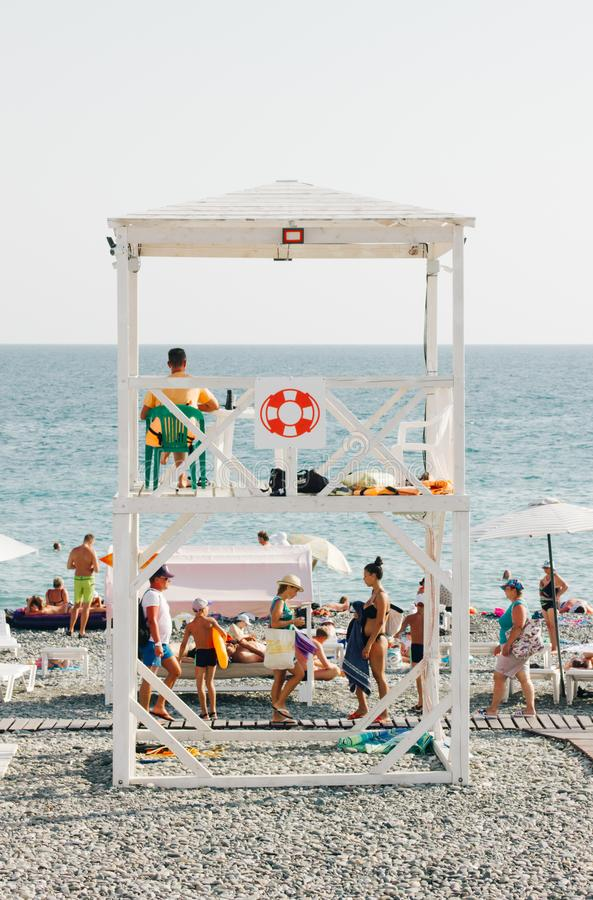 People Near Beach With Lifeguard Gazebo stock photography