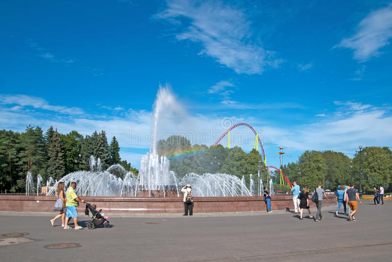People near fountain on Krestovsky Island. St. Petersburg. Russia stock photo