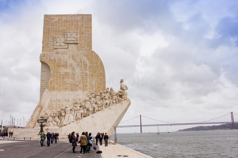 People near the Monument of Discoveries , Lisbon. Monument of the Discoveries is a monument on the northern bank of the Tagus River estuary, in the civil parish stock photography