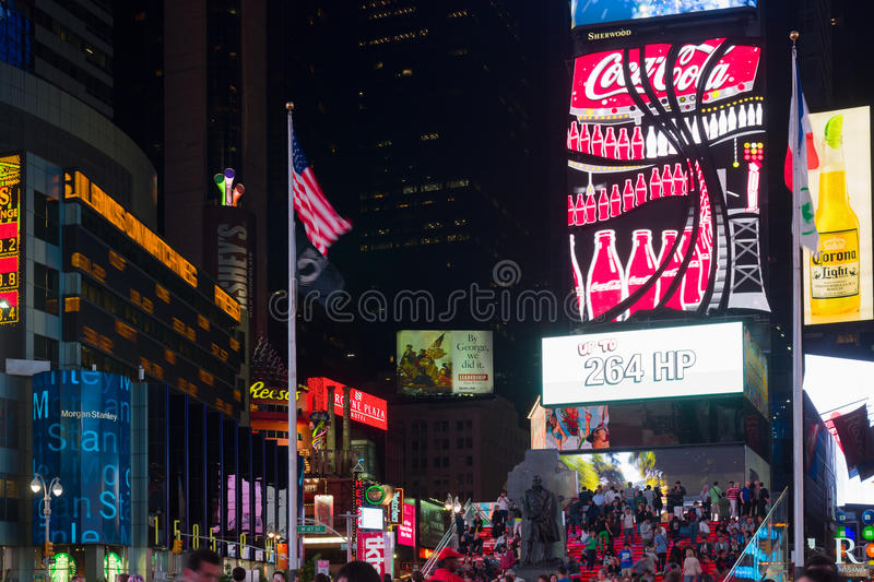 People at night Times Square. NEW YORK - JUNE 6: People at night Times Square on June 6, 2013 in New York. Approximately 300 000 people pass through Times Square stock image