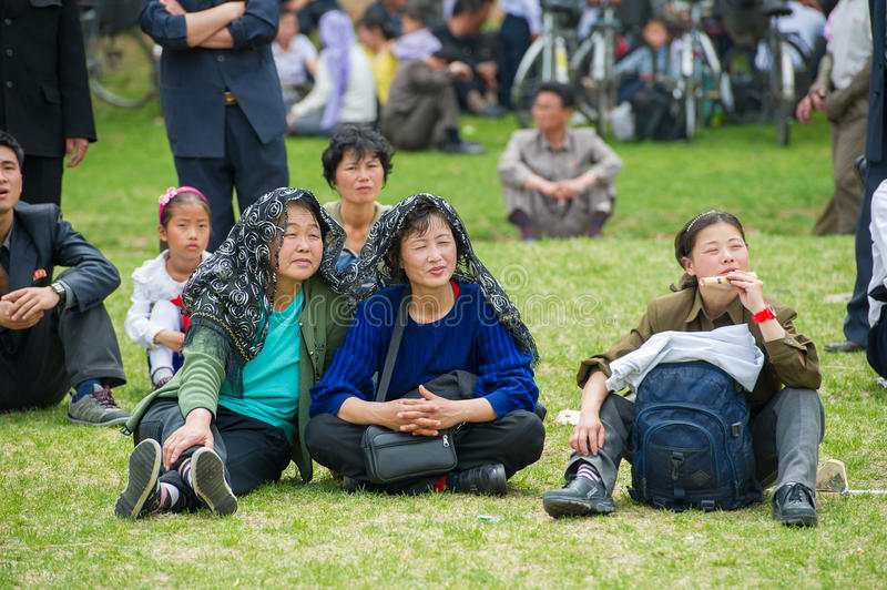 People in NORTH KOREA. NORTH KOREA - MAY 1, 2012: Korean family during the celebration of the International Worker's Day in N.Korea, May 1, 2012. May 1 is a stock photography
