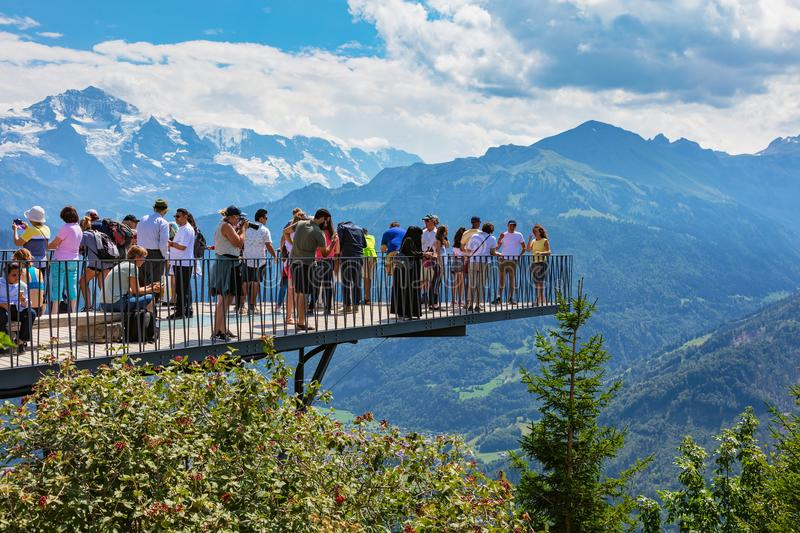 People on the observation platform on the top of Mt. Harder. Mt. Harder, Switzerland - August 7, 2018: people on the observation platform on the Harderkulm. The stock image