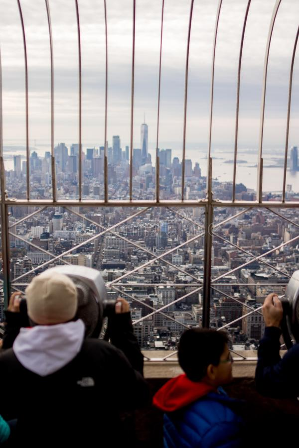 People looking New York skyline from The Empire State Building observation deck royalty free stock images
