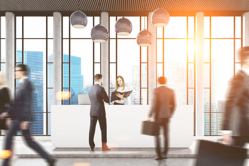 People in office with skyscraper. Businesspeople are passing by a reception counter in an office with a skyscraper seen through a panoramic window. 3d rendering stock photos