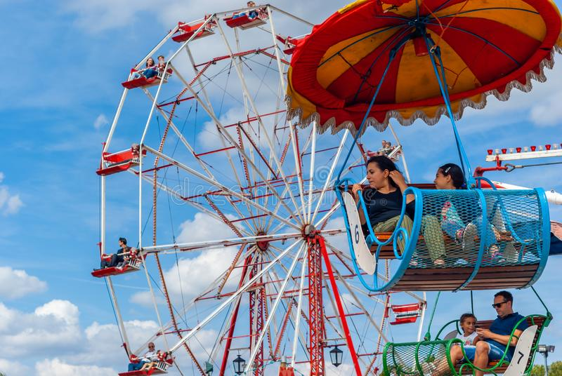 People in old-fashioned fairground attractions royalty free stock image