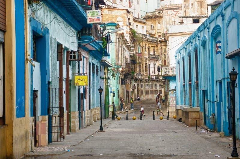 People in an old neighborhood in Havana