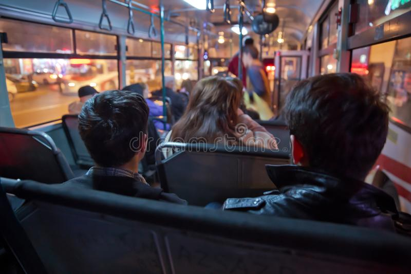 People in old public bus, view from inside the bus . People sitting on a comfortable bus in Selective focus and blurred background royalty free stock photos