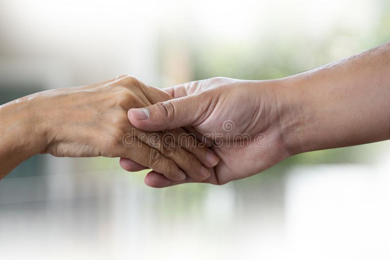 People old woman  and young hand holding Disabled walking with assistance stock image