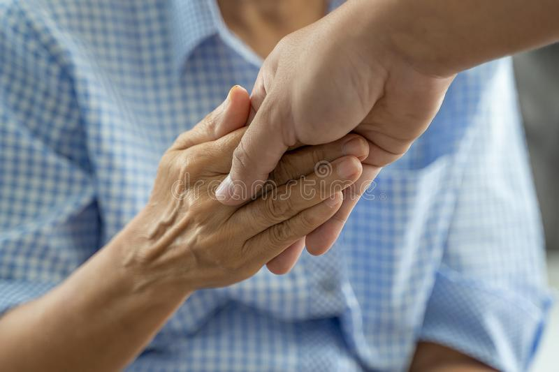 People old woman  and young hand holding Disabled walking with assistance stock photography