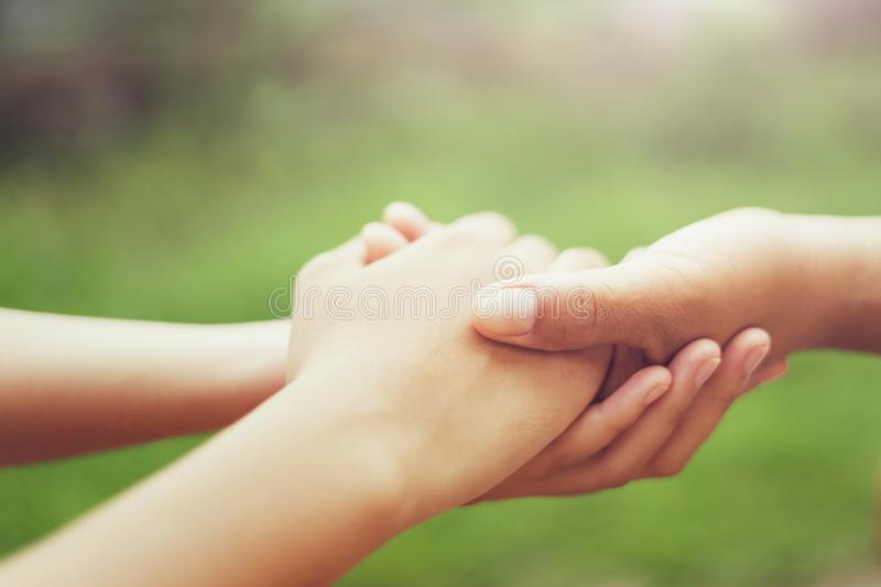 people old and young hand holding with sunlight. concept power of hope stock photos