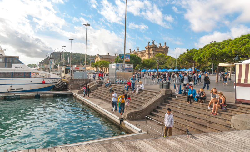 People outdoors, some waiting for their ship to come in, in Ramba Del Mar, Barcelona. Sunshine in coastal Catalonia, Barcelona. stock photos