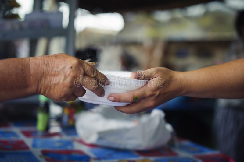 People outreach to donate food from volunteers : Food concept of hope : Free food for poor and homeless people donates food to. Food less people : Social royalty free stock photo