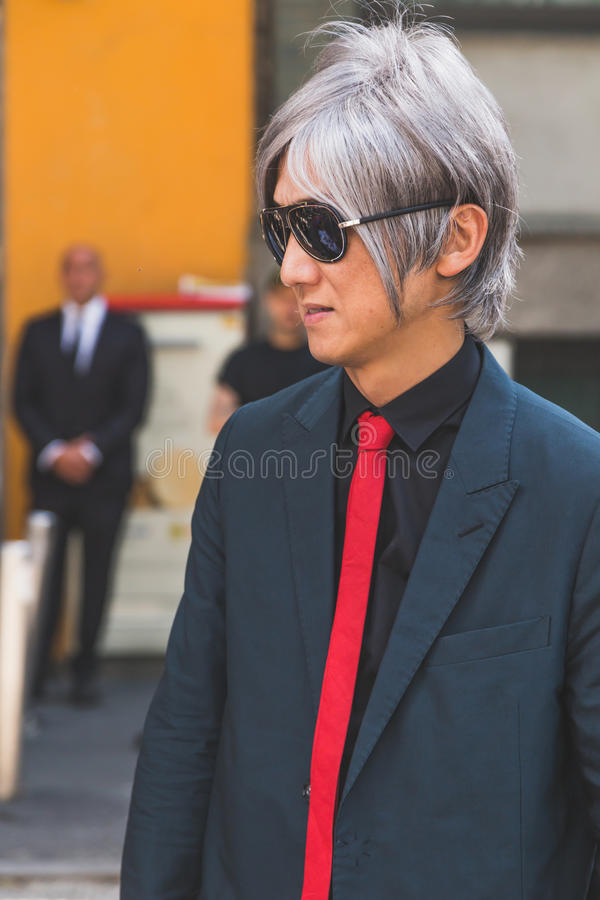 People outside Armani fashion show building for Milan Men's Fash royalty free stock photography