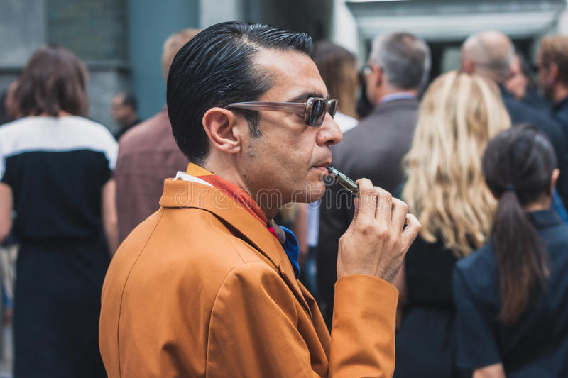 People outside Armani fashion shows building for Milan Men's Fashion Week 2014 stock photography