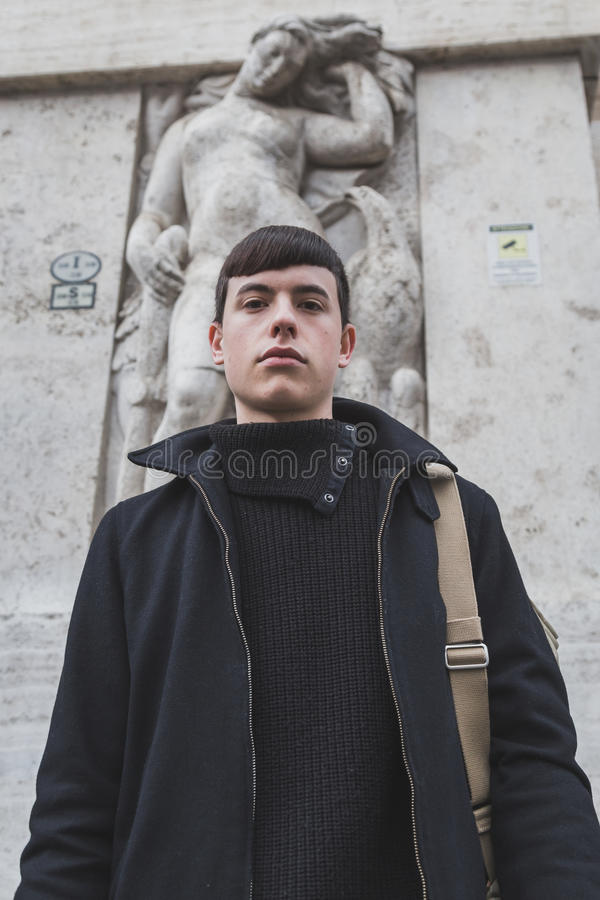 People outside Ferragamo fashion show building for Milan Men's Fashion Week 2015 royalty free stock images