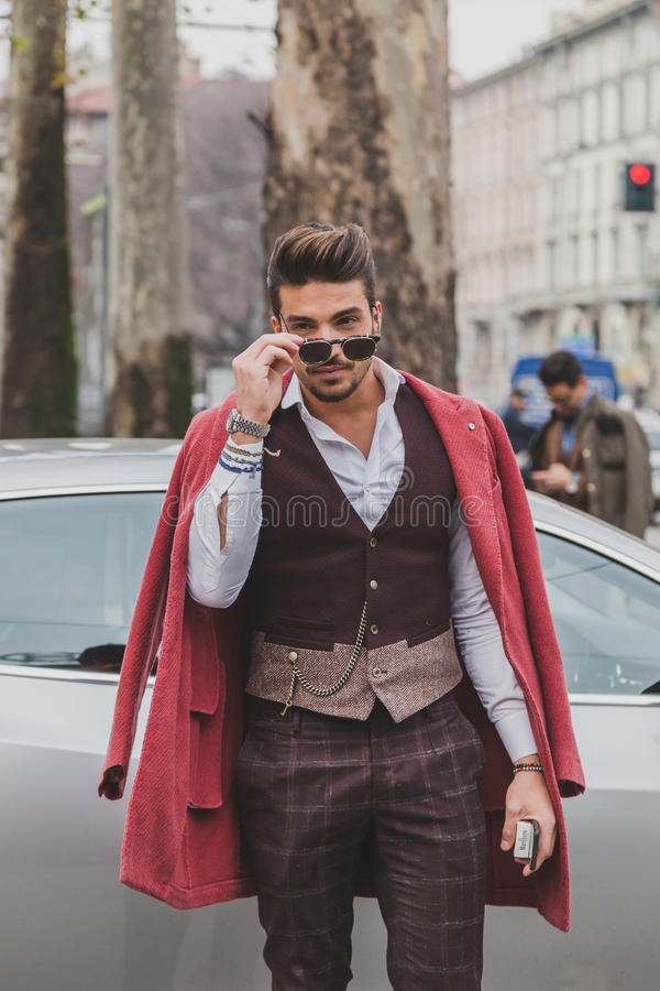 People outside Gucci fashion show building for Milan Men's Fashion Week 2015 royalty free stock photography